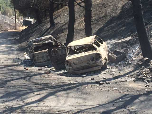 Burned-out cars on Iron Canyon Road. Signal photo by Jim Holt