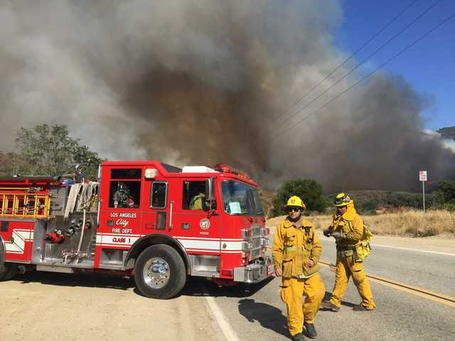 L.A. city firefighters at a staging area on Placerita Canyon. Staff photo by Katharine Lotze