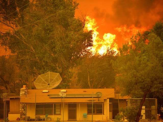 The backyard of a home on Soledad Canyon Road burns on Sunday. Photo courtesy of Rick McClure