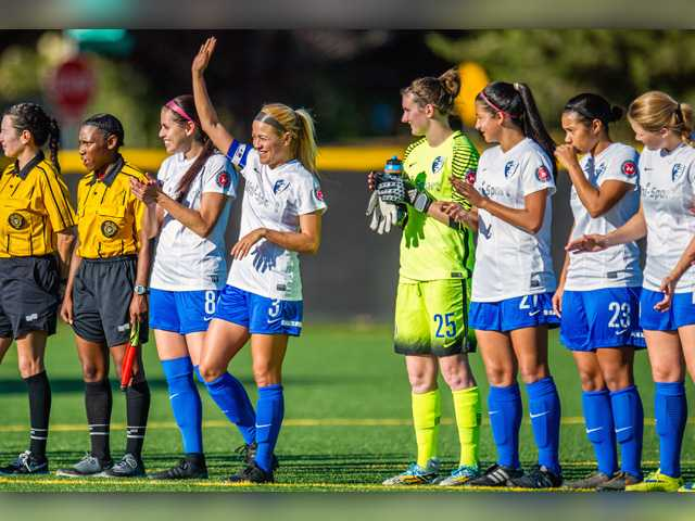 Captain Yadira Toraya holds up her hand, recognizing the fans during Blue Heat pre-game announcements. Photo courtesy of @TmesisFC.