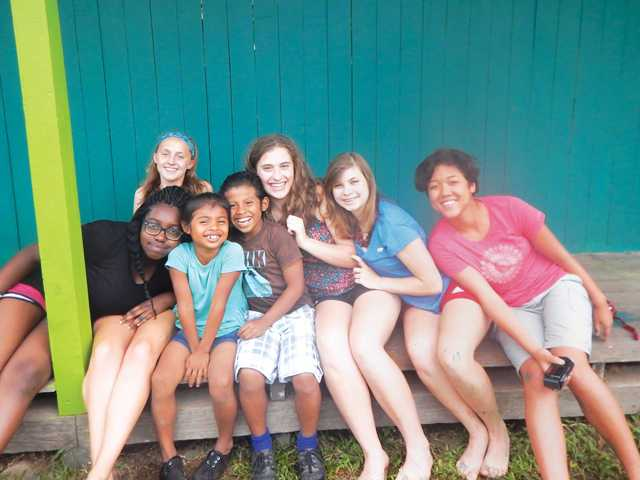 • Erin Nahas, second from right, with her Girl Scout teammates relaxing during their trip to Costa Rica. Courtesy photo