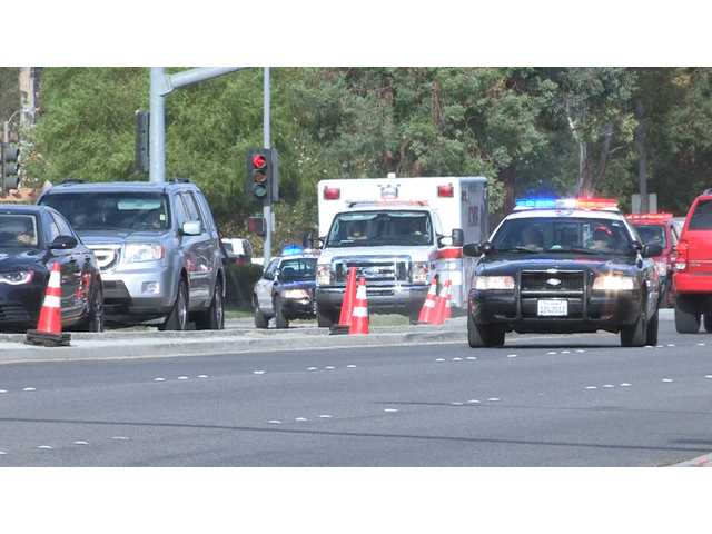 Deputies with the Santa Clarita Valley Sheriff's Station block intersections along McBean Parkway Monday to allow paramedics clear access to Henry Mayo Newhall Hospital as they transport a baby feared drowned. Photo by Austin Dave.