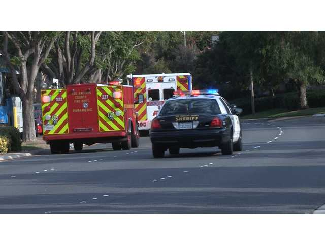 Deputies with the Santa Clarita Valley Sheriff's Station block intersections along McBean Parkway Monday to allow paramedics clear access to Henry Mayo Newhall Hospital as they transport a baby feared drowned. Photo by Austin Dave