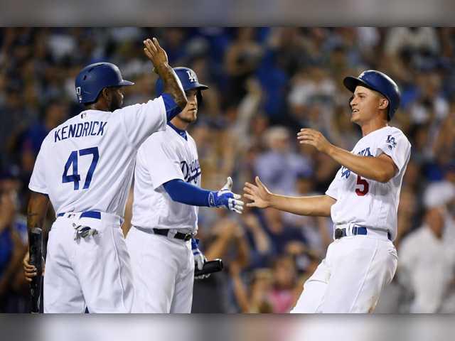 Dodgers rough up Bumgarner, beat Giants