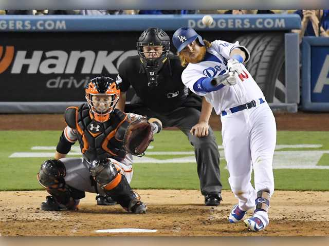 Hill solid, Turner homers and Dodgers beat Giants
