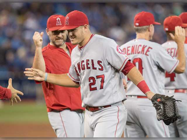 Pujols reaches 100 RBIs for 13th time, Angels beat Jays