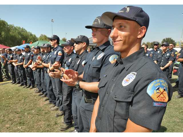 Members of Los Angeles County Camp Crew 12 applaud speeches during the First Responder Thank You Party held at Central Park in Saugus Saturday. Photo by Dan Watson / The Signal