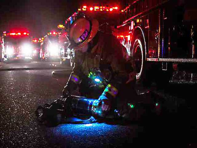 Late night blaze consumes RV, damages home
