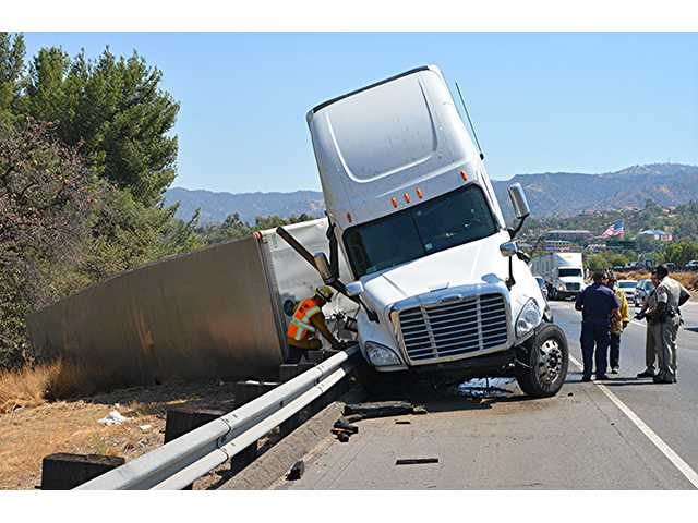 Crash involving big rig causes sig alert, fuel spill