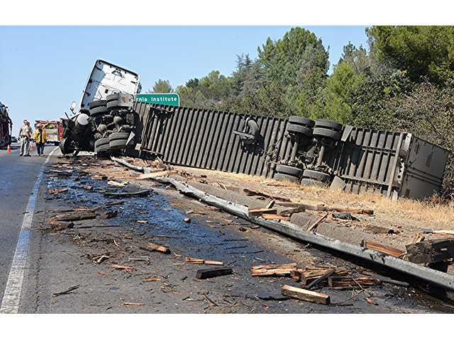 Crash involving big rig causes sig alert, fuel spill