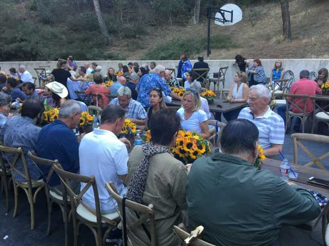 Attendees gather Saturday for a barbecue which was held at Rancho Deluxe Film Studio in Canyon Country benefiting four firefighters and their families who lost their homes in the Sand Fire.