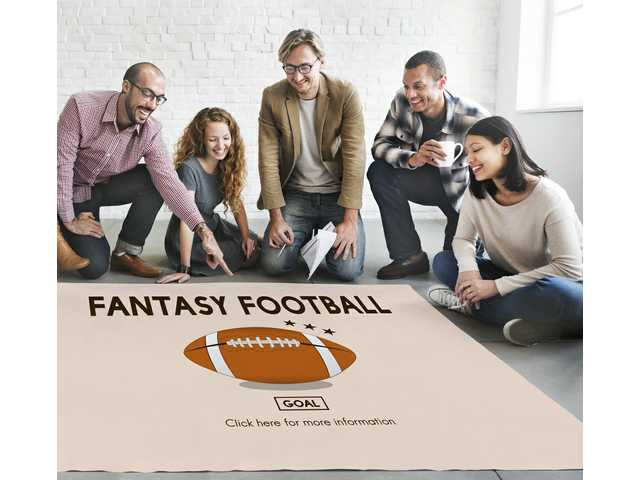 How fantasy football can be a cost and a benefit at the office