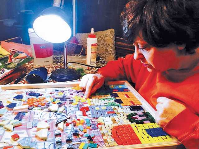 Saugus resident and artist Naomi Young working on a mosaic art piece. Courtesy photo