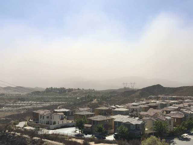 High winds create dusty skies in SCV