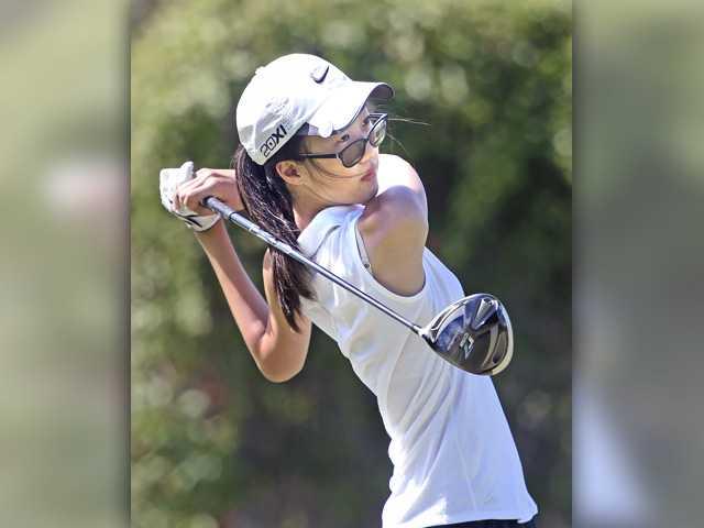 Ashley Song of Valencia drives the ball at Elkins Ranch on Tuesday. Signal photo by Dan Watson.