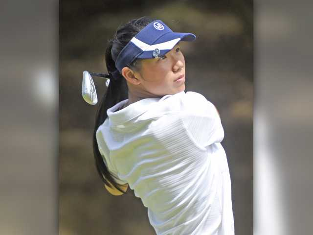West Ranch's Noelle Song hits off the 4th tee Tuesday. Signal photo by Dan Watson.