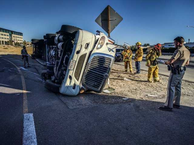 Big rig flips in Castaic at rush hour