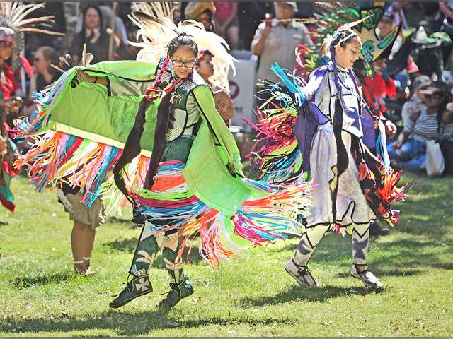 Ashley Martinez, 14, left, and her cousin Ava Trepepi, 13, dance the fancy shawl dance during the intertribal dance at the 23rd Annual Hart of the West PowWow & Native American Craft Fair held at William S. hart park in Newhall on Saturday. Dan Watson/The Signal