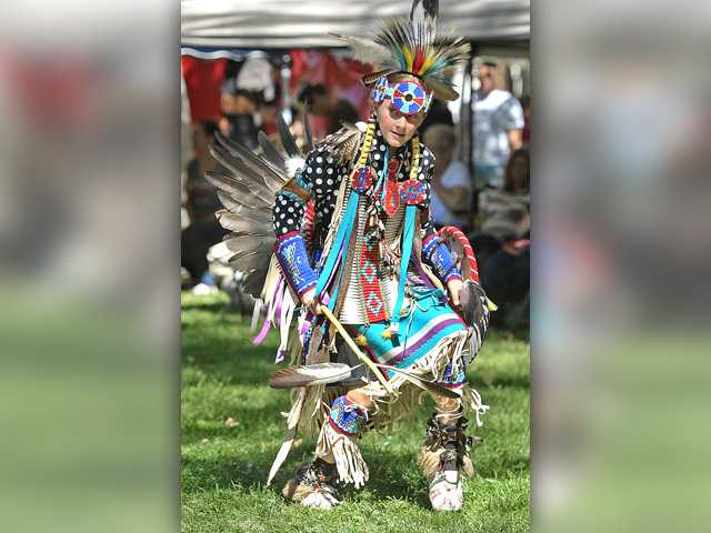 Gavin Watts, 13, dances wearing the northern traditional regalia including eagle wing feather bustle, bone breast plate and porcupine hair roach during the inter-tribal dance at the 23rd Annual Hart of the West PowWow & Native American Craft Fair held at William S. Hart Park in Newhall on Saturday. Dan Watson/The Signal
