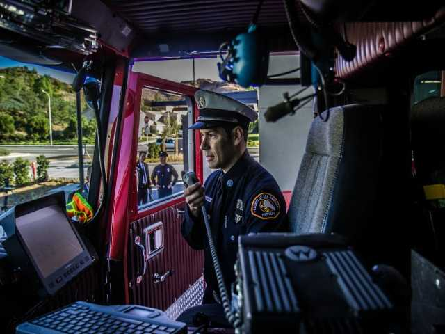 Fire Capt. Daniel Trevizo dispatches Station 143 into service at 8 a.m. Saturday morning. The firehouse will serve the Hasley Canyon area of Castaic. Austin Dave/The Signal