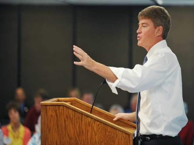 In this Aug. 5, 2016 file photo, Missouri Attorney General and Democrat candidate for governor, Chris Koster, addresses members of the Missouri Farm Bureau in Jefferson City, Mo. Gubernatorial candidates in some states including Missouri have been staking strategic positions contrary to their party's national norms and presidential nominees. Attorney General Koster faces Republican nominee, former Navy SEAL officer, Eric Greitens in the general election. (Julie Smith/The Jefferson City News-Tribune via AP File)