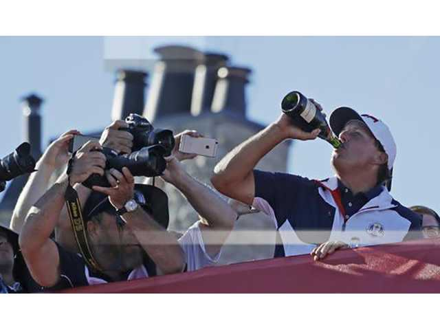United States' Phil Mickelson drinks Champagne after the United States team won the Ryder Cup golf tournament Sunday, Oct. 2, 2016, at Hazeltine National Golf Club in Chaska, Minn. (AP Photo/Chris Carlson)