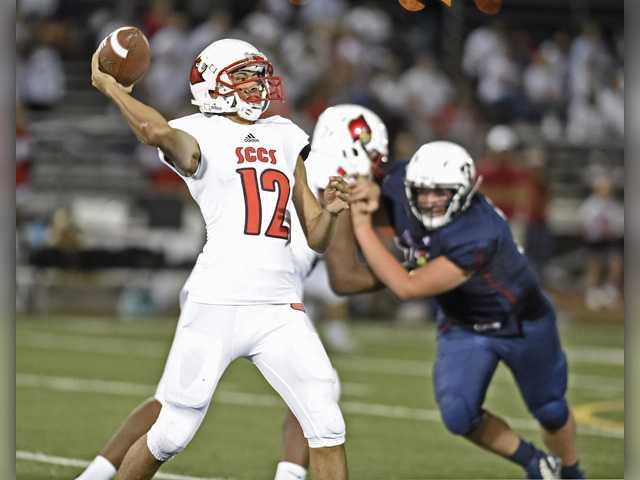 SCCS quarterback Tristan Miller (12) passes against Trinity on Saturday. Dan Watson/ The Signal