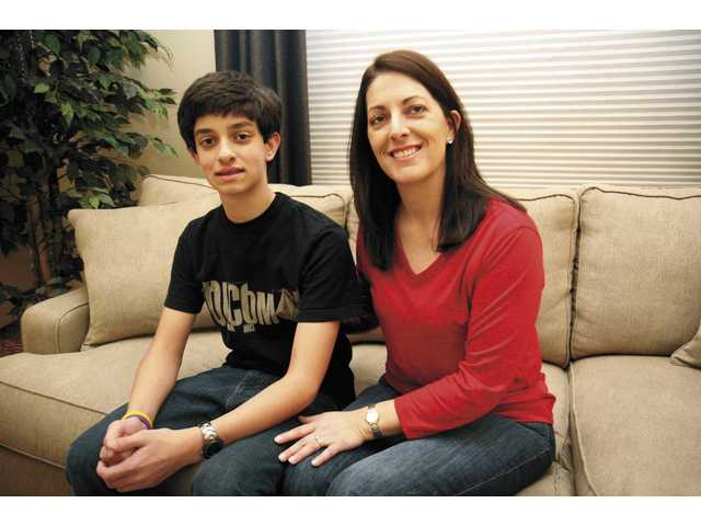Matthew and Carol Mazie relax at their Valencia home. Matthew has had asthma all his life, inspiring him to raise money for others with the disease.