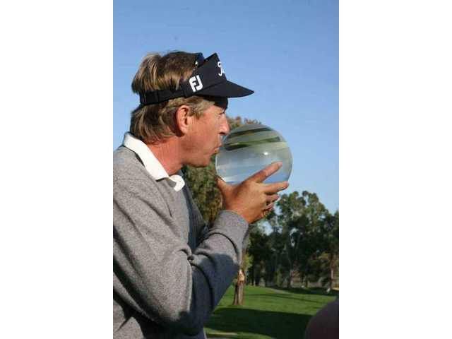 Dan Forsman greets the winner's orb against a clear blue sky after edging Don Pooley in a playoff hole to win the 2009 AT&T Champions Classic tournament at Valencia Country Club Sunday.