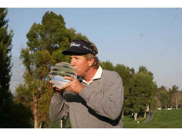 How sweet it is: Dan Forsman gets acquainted with the symbol of success after winning the 2009 AT&T Champions Classic Sunday at Valencia Country Club.