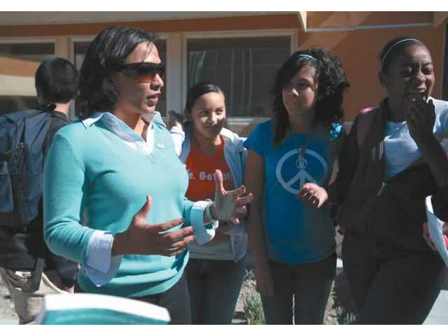 Erum Jones, principal of the Early High School Program of the Sierra Highway COC campus, talks with some of her students during their lunch break Tuesday afternoon. Eight-six of her students are taking college courses while working to garner their high school diploma.