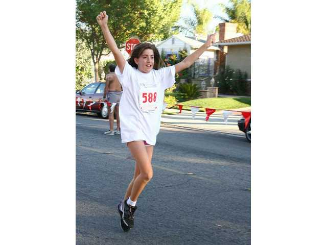 Instead of running or walking, 11-year-old Leta Perriello, of Canyon Country, skips through the 5K run against hunger on Sunday.