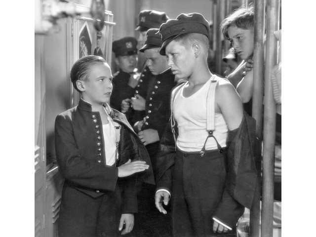 "Jackie Coogan (left), later star of ""The Addams Family,"" costarred with Coy Watson Jr. (right) in 1927's ""Buttons."""