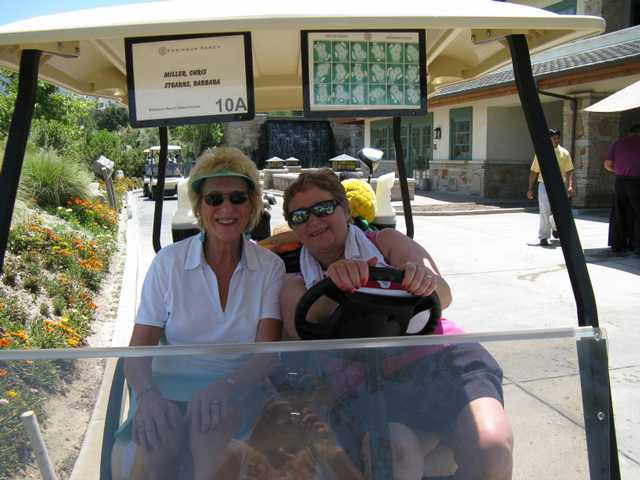 Barbara Stearn Cochran and Chris Miller of Zonta Club of SCV  check on the golfers on the course during the 2008 event.