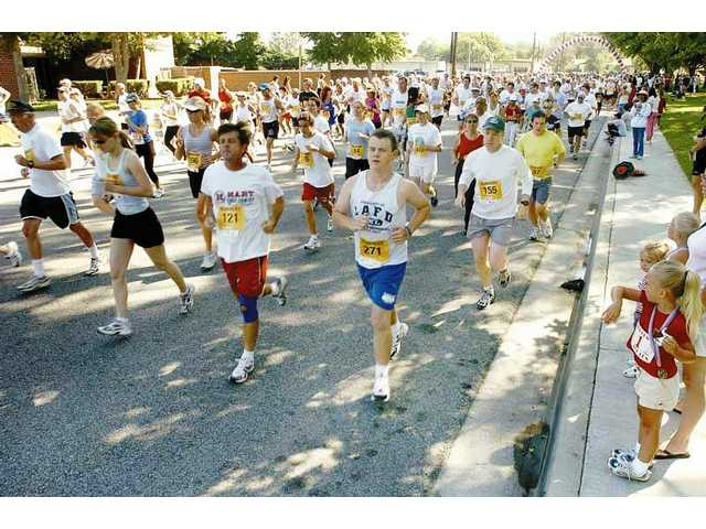 SC Runners hosts the 5K run preceding the Santa Clarita Fourth of July Parade in Newhall.