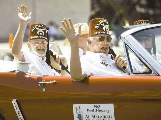 Members of Al Malaikah rolled in a 1965 'Stang ragtop in the 2008 Santa Clarita Fourth of July parade in Newhall.