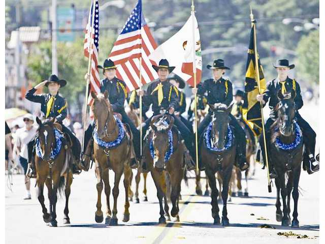 A mounted honor guard helps get the Santa Clarita Fourth of July parade off and running through the streets of Newhall.