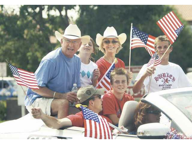 "U.S. Prepresentative Howard P. ""Buck"" McKeon (R-Calif., 25th District) and members of his family paraded up Lyons Avenue during Santa Clarita's 2008 Fourth of July Parade."