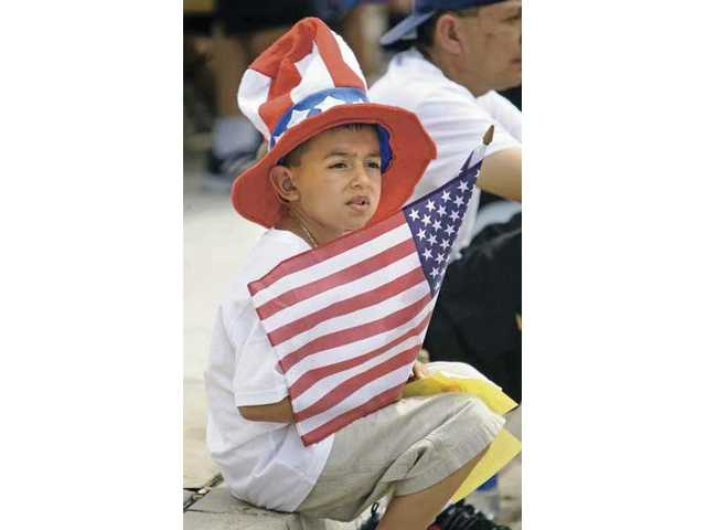 A boy enjoys the parade on Lyons Avenue during the 2008 Santa Clarita Fourth of July parade through Newhall.