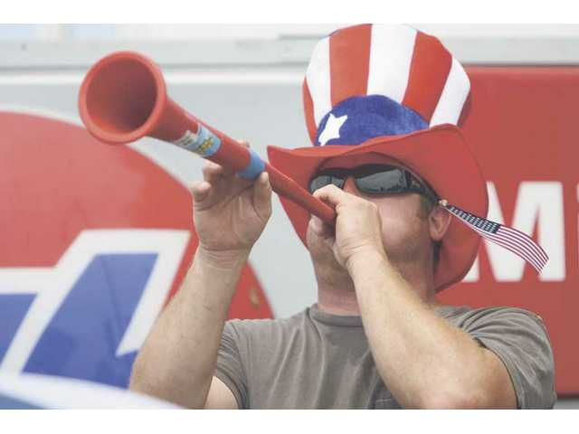 """Uncle Sam"" blows his parade horn during the 2008 Santa Clarita Fourth of July parade through Newhall."