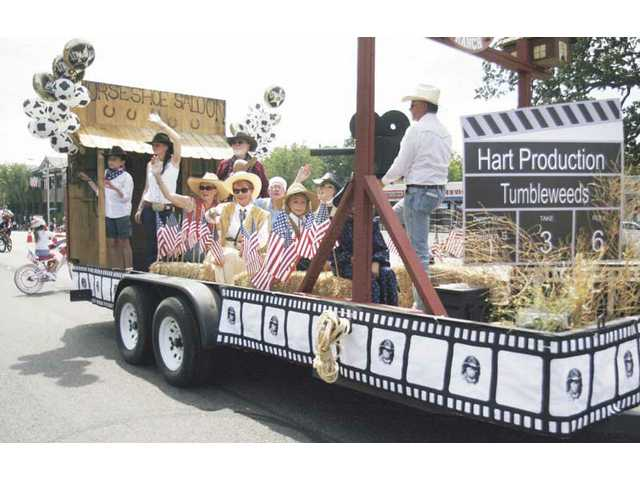 A movie-themed floatrolls througha townrich movie history, during a recent Fourth of July parade in Newhall.