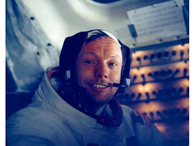 Armstrong in LM after historic moonwalk.