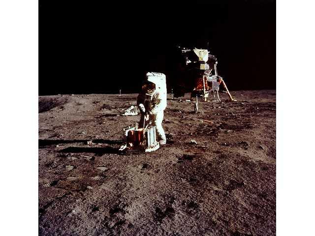 Aldrin assembles seismic experiment.