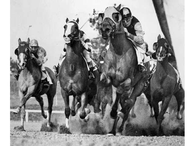 Photographer Coy Watson Jr. caught this under-the-rail shot at Santa Anita Race Track's opening season in 1938.