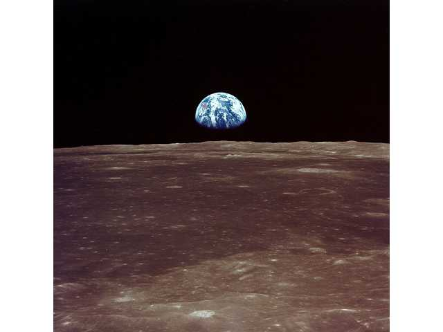 Earthrise viewed from lunar orbit prior to landing.