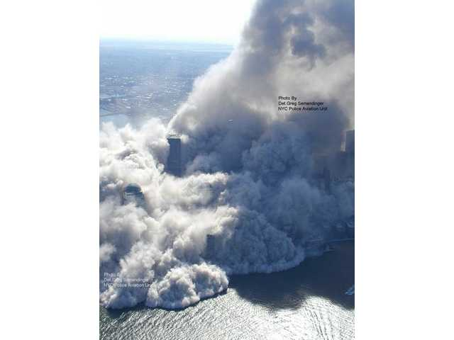 This photo taken Sept. 11, 2001 by the New York City Police Department and obtained by ABC News, which claims to have obtained it under the Freedom of Information Act, shows smoke and ash rising in the area around the World Trade Center in New York.