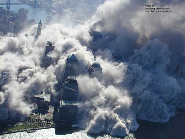 This photo taken Sept. 11, 2001 by the New York City Police Department and obtained by ABC News, which claims to have obtained it under the Freedom of Information Act, shows smoke and ash rising above downtown high-rise buildings and engulfing lower Manhattan in New York.
