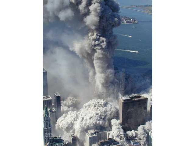 This photo taken Sept. 11, 2001 by the New York City Police Department and obtained by ABC News, which claims to have obtained it under the Freedom of Information Act, shows one of the towers of the World Trade Center in New York as it begins to collapse.