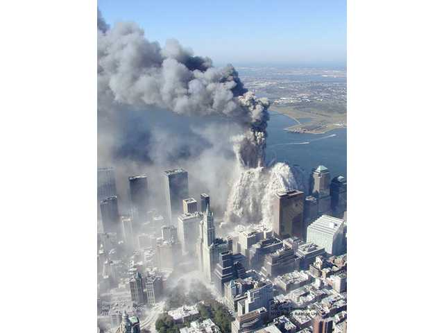 This photo taken Sept. 11, 2001 by the New York City Police Department and obtained by ABC News, which claims to have obtained it under the Freedom of Information Act, shows one of the towers of the World Trade Center in New York as it begins to crumble.