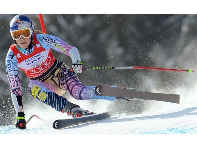 Lindsey Vonn speeds down the course on her way to win an alpine ski, Women's World Cup super-G, in Garmisch-Partenkirchen, Germany, Friday, March 12, 2010. Vonn has won her third straight overall World Cup title.